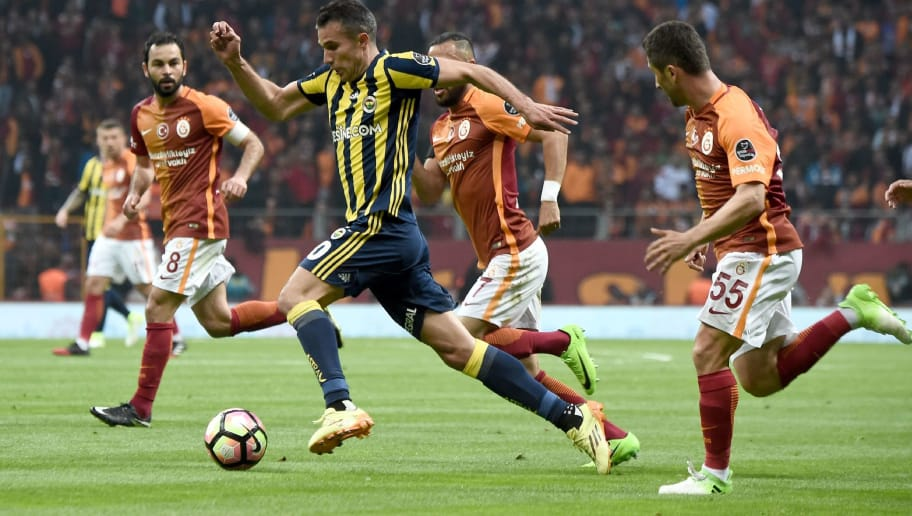 Fenerbahce's Dutch Forward forward Robin Van Persie (2nd-L) drives the ball during the Turkish Spor Toto Super Lig football match between Galatasaray and Fenerbahce at the TT Arena stadium in Istanbul on April 23, 2017.  / AFP PHOTO / OZAN KOSE        (Photo credit should read OZAN KOSE/AFP/Getty Images)