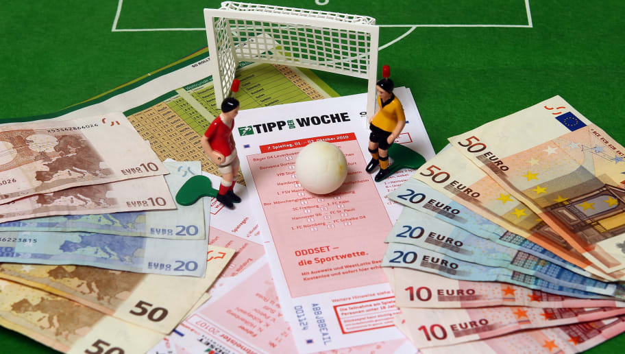 DINSLAKEN, GERMANY - OCTOBER 02:  This photo illustration shows betting slips together with Euro bank notes and a table soccer game on October 2, 2010 in Dinslaken, Germany. The first two suspects in Germany in Europe's biggest football betting scandal ever will face charges in a trial to begin in Bochum on October 6 over attempting to rig at least 24 matches in Europe, including matches in Germany's second division 2. Bundesliga league. In all prosecutors are investigating 250 suspects for attempting to influence the outcome of some 270 matches across Europe. Prosecutor claim the betting ring made profits of at least EUR 7.5 million on manipulated games.  (Photo Illustration by Lars Baron/Bongarts/Getty Images)