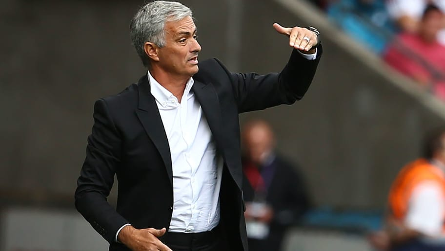 Manchester United's Portuguese manager Jose Mourinho gestures during the English Premier League football match between Swansea City and Manchester United at The Liberty Stadium in Swansea, south Wales on August 19, 2017. / AFP PHOTO / Geoff CADDICK / RESTRICTED TO EDITORIAL USE. No use with unauthorized audio, video, data, fixture lists, club/league logos or 'live' services. Online in-match use limited to 75 images, no video emulation. No use in betting, games or single club/league/player publications.  /         (Photo credit should read GEOFF CADDICK/AFP/Getty Images)