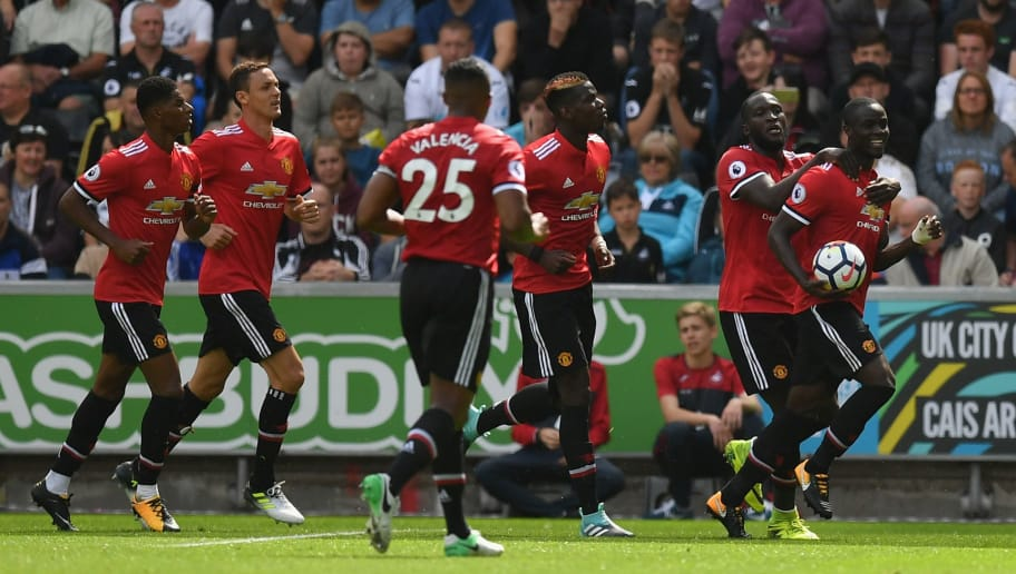 SWANSEA, WALES - AUGUST 19:  Eric Bailly of Manchester United celebrates scoring his sides first goal with his Manchester Untited team mates during the Premier League match between Swansea City and Manchester United at Liberty Stadium on August 19, 2017 in Swansea, Wales.  (Photo by Dan Mullan/Getty Images)