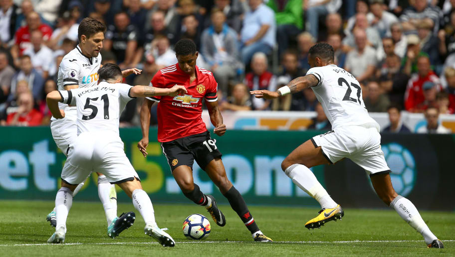 Manchester United's English striker Marcus Rashford (C) vies with Swansea City's Spanish midfielder Roque Mesa (L) and Swansea City's English defender Kyle Bartley during the English Premier League football match between Swansea City and Manchester United at The Liberty Stadium in Swansea, south Wales on August 19, 2017. / AFP PHOTO / GEOFF CADDICK / RESTRICTED TO EDITORIAL USE. No use with unauthorized audio, video, data, fixture lists, club/league logos or 'live' services. Online in-match use limited to 75 images, no video emulation. No use in betting, games or single club/league/player publications.  /         (Photo credit should read GEOFF CADDICK/AFP/Getty Images)