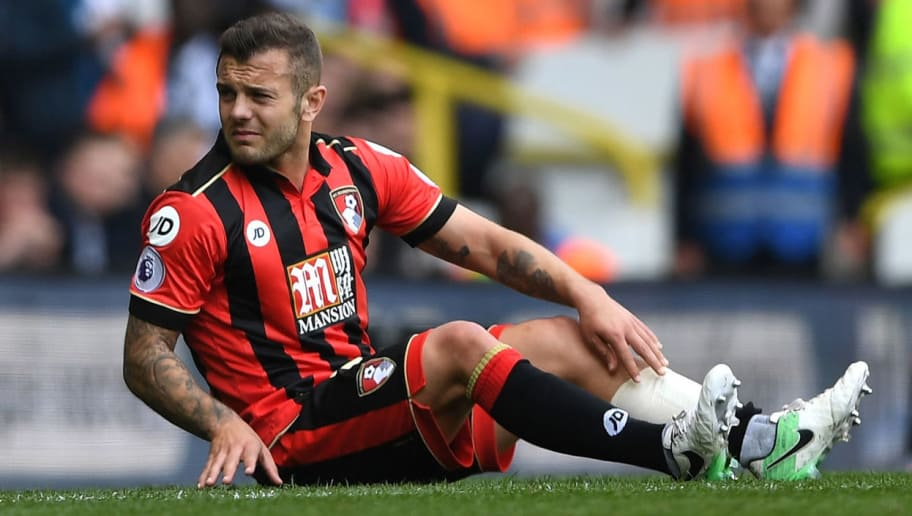 LONDON, ENGLAND - APRIL 15: Jack Wilshere of AFC Bournemouth goes down injured during the Premier League match between Tottenham Hotspur and AFC Bournemouth at White Hart Lane on April 15, 2017 in London, England.  (Photo by Shaun Botterill/Getty Images)