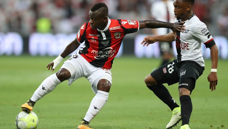 Nice's Ivorian midfielder Jean Michael Seri (L) vies with Guingamp's South-African midfielder Lebogang Phiri (R) during the French L1 football match Nice (OGCN) vs Guingamp (EAG) on August 19, 2017 at the 'Allianz Riviera' stadium in Nice, southeastern France. / AFP PHOTO / VALERY HACHE        (Photo credit should read VALERY HACHE/AFP/Getty Images)