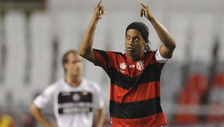 RIO DE JANEIRO, BRAZIL - APRIL 12: Ronaldinho of Flamengo celebrates a scored goal of Luis Antonio againist  Lanus during a match between Flamengo and Lanus as part of the Copa Libertadores 2012 at Joao Havelange Stadium on April 12, 2012 in Rio de Janeiro, Brazil. (Photo by Buda Mendes/LatinContent/Getty Images)