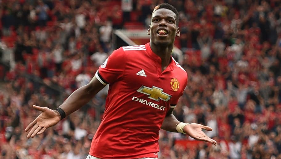 Manchester United's French midfielder Paul Pogba celebrates after scoring their fourth goal during the English Premier League football match between Manchester United and West Ham United at Old Trafford in Manchester, north west England, on August 13, 2017. / AFP PHOTO / Oli SCARFF / RESTRICTED TO EDITORIAL USE. No use with unauthorized audio, video, data, fixture lists, club/league logos or 'live' services. Online in-match use limited to 75 images, no video emulation. No use in betting, games or single club/league/player publications.  /         (Photo credit should read OLI SCARFF/AFP/Getty Images)