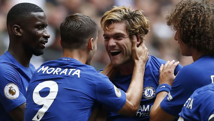 Chelsea's Spanish defender Marcos Alonso (C) celebrates with teammates scoring the team's first goal during the English Premier League football match between Tottenham Hotspur and Chelsea at Wembley Stadium in London, on August 20, 2017. / AFP PHOTO / IKIMAGES / Ian KINGTON / RESTRICTED TO EDITORIAL USE. No use with unauthorized audio, video, data, fixture lists, club/league logos or 'live' services. Online in-match use limited to 45 images, no video emulation. No use in betting, games or single club/league/player publications.        (Photo credit should read IAN KINGTON/AFP/Getty Images)