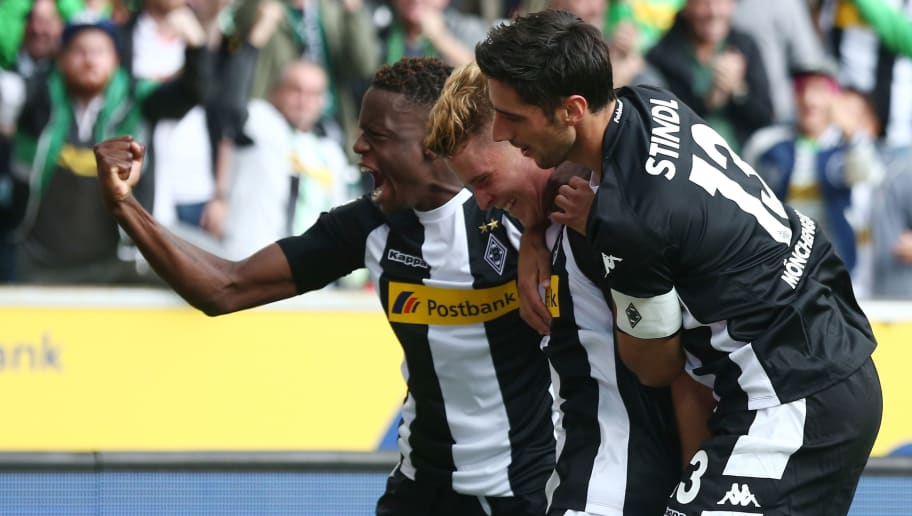MOENCHENGLADBACH, GERMANY - AUGUST 20: Nico Elvedi of Moenchengladbach (center) celebrates having scored his teams first goal with Ibrahima Traore of Moenchengladbach (left) and Lars Stindl of Moenchengladbach (right) during the Bundesliga match between Borussia Moenchengladbach and 1. FC Koeln at Borussia-Park on August 20, 2017 in Moenchengladbach, Germany. (Photo by Christof Koepsel/Bongarts/Getty Images)