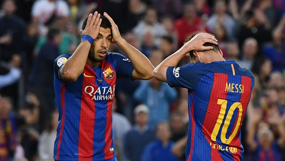 BARCELONA, SPAIN - MAY 21:  Lionel Messi of Barcelona and Luis Suarez of Barcelona look dejected during the La Liga match between Barcelona and Eibar at Camp Nou on 21 May, 2017 in Barcelona, Spain.  (Photo by David Ramos/Getty Images)