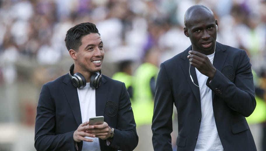 Manchester City midfielder Samir Nasri (L) and midfielder Yaya Toure are seen prior to the International Champions Cup match between Real Madrid and Manchester City on July 26, 2017 in Los Angeles, California.  / AFP PHOTO / RINGO CHIU        (Photo credit should read RINGO CHIU/AFP/Getty Images)