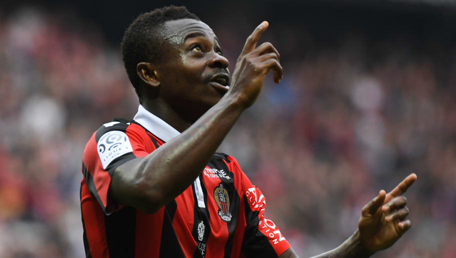 Nice's Ivorian midfielder Jean Michael Seri  celebrates after scoring a goal during the French L1 football match OGC Nice vs AS Nancy-Lorraine at the Allianz Riviera Stadium in Nice on April 15, 2017. / AFP PHOTO / Yann COATSALIOU        (Photo credit should read YANN COATSALIOU/AFP/Getty Images)