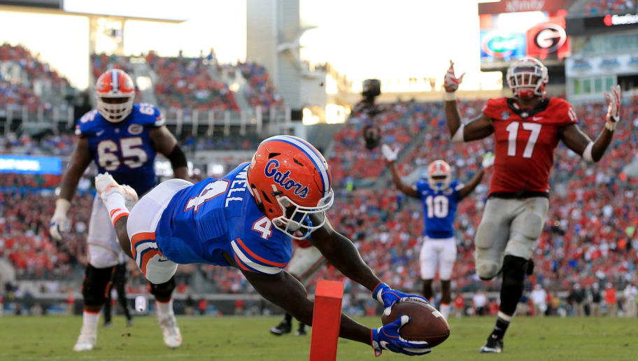 JACKSONVILLE, FL - OCTOBER 29: Brandon Powell #4 of the Florida Gators dives for the pylon after stepping out of bounds during the second half of the game against the Georgia Bulldogs at EverBank Field on October 29, 2016 in Jacksonville, Florida. (Photo by Rob Foldy/Getty Images)