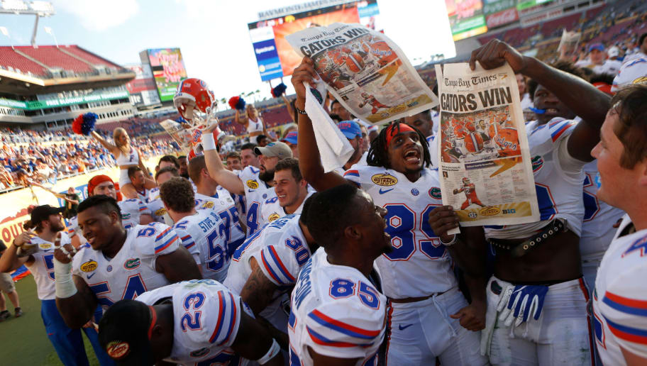 TAMPA, FL - JANUARY 2:  The Florida Gators celebrate their 30-3 win over the Iowa Hawkeyes at the conclusion of the Outback Bowl NCAA college football game on January 2, 2017 at Raymond James Stadium in Tampa, Florida. (Photo by Brian Blanco/Getty Images)