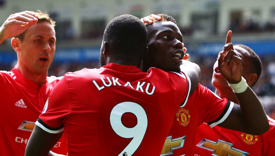 Manchester United's French midfielder Paul Pogba (R) celebrates with Manchester United's Belgian striker Romelu Lukaku (L) scoring the team's fourth goal during the English Premier League football match between Swansea City and Manchester United at The Liberty Stadium in Swansea, south Wales on August 19, 2017. / AFP PHOTO / Geoff CADDICK / RESTRICTED TO EDITORIAL USE. No use with unauthorized audio, video, data, fixture lists, club/league logos or 'live' services. Online in-match use limited to 75 images, no video emulation. No use in betting, games or single club/league/player publications.  /         (Photo credit should read GEOFF CADDICK/AFP/Getty Images)