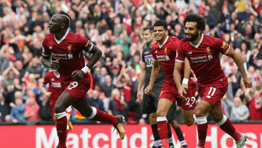 LIVERPOOL, ENGLAND - AUGUST 19: Sadio Mane of Liverpool celebrates scoring his sides first goal with his Liverpool team mates during the Premier League match between Liverpool and Crystal Palace at Anfield on August 19, 2017 in Liverpool, England.  (Photo by Jan Kruger/Getty Images)