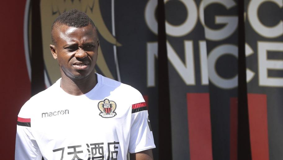 Nice's Ivorian midfielder Jean Michael Seri arrives to attend a training session on the eve of the UEFA Champions League football match between Nice and Naples on August 21, 2017 at the Allianz Riviera stadium in Nice, southeastern France. / AFP PHOTO / VALERY HACHE        (Photo credit should read VALERY HACHE/AFP/Getty Images)