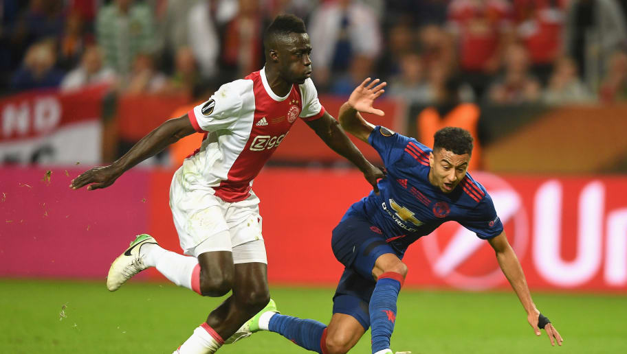 STOCKHOLM, SWEDEN - MAY 24:  Jesse Lingard of Manchester United is tackled by Davinson Sánchez of Ajax  during the UEFA Europa League Final between Ajax and Manchester United at Friends Arena on May 24, 2017 in Stockholm, Sweden.  (Photo by Mike Hewitt/Getty Images)