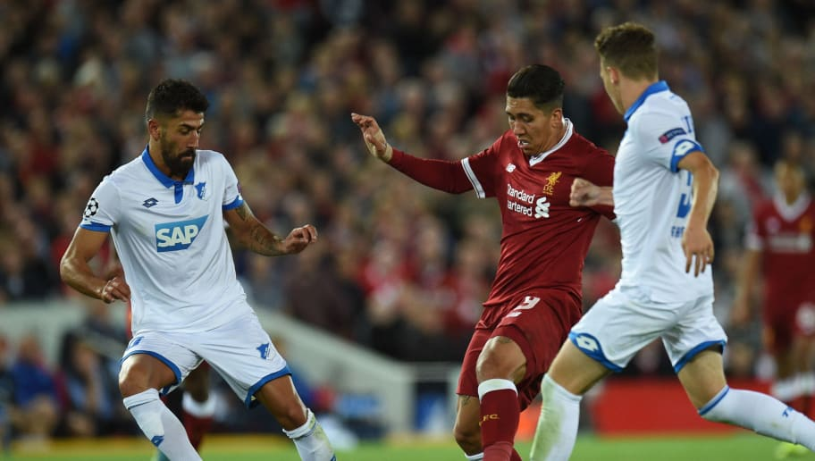 Liverpool's Brazilian midfielder Roberto Firmino (C) controls the ball during the Champions League qualifier, second leg match between Liverpool and Hoffenheim at Anfield stadium in Liverpool on August 23, 2017. / AFP PHOTO / Oli SCARFF        (Photo credit should read OLI SCARFF/AFP/Getty Images)