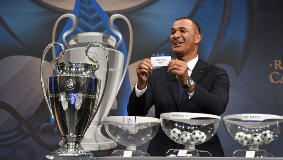 Netherlands' former striker Ruud Gullit shows the name of Barcelona during the draw for the round of 16 of the UEFA Champions League football tournament at the UEFA headquarters in Nyon on December 12, 2016. / AFP / Fabrice COFFRINI        (Photo credit should read FABRICE COFFRINI/AFP/Getty Images)