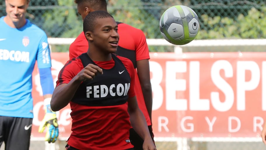 Monaco L1 football club's forward Kylian Mbappe Lottin takes part in a training session on August 11, 2017 in La Turbie, near Monaco.   / AFP PHOTO / VALERY HACHE        (Photo credit should read VALERY HACHE/AFP/Getty Images)