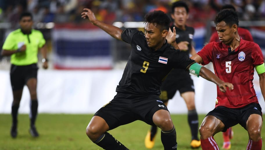 Chenrop Samphaodi (#9) of Thailand vies for the ball with Soeuy Visal of Cambodia during the men's football preliminary match of the 29th Southeast Asian Games (SEA Games) in Kuala Lumpur on August 20, 2017. / AFP PHOTO / ADEK BERRY        (Photo credit should read ADEK BERRY/AFP/Getty Images)