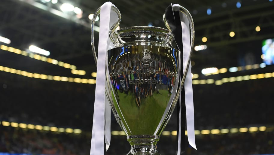 The UEFA Champions League trophy is pictured beside the pitch ahead of the UEFA Champions League final football match between Juventus and Real Madrid in Cardiff, south Wales, on June 3, 2017. / AFP PHOTO / Glyn KIRK        (Photo credit should read GLYN KIRK/AFP/Getty Images)