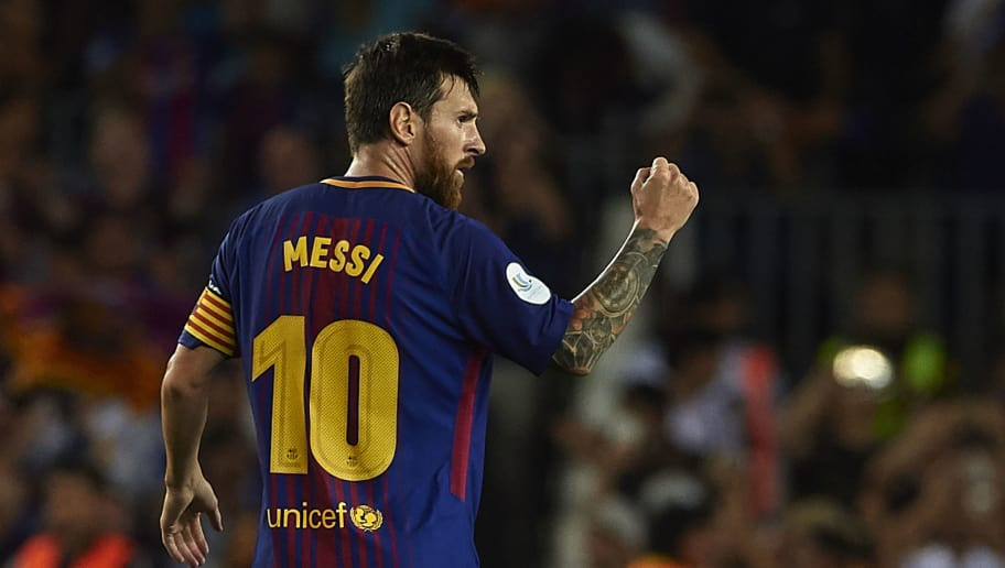 BARCELONA, SPAIN - AUGUST 13:  Lionel Messi of Barcelona celebrates scoring his team's first goal during the Supercopa de Espana Supercopa Final 1st Leg match between FC Barcelona and Real Madrid at Camp Nou on August 13, 2017 in Barcelona, Spain.  (Photo by Manuel Queimadelos Alonso/Getty Images,)