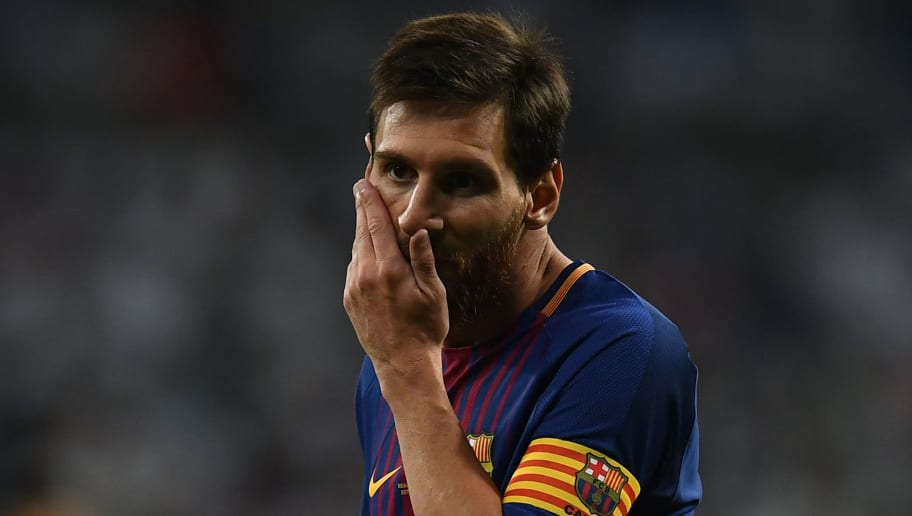 Barcelona's Argentinian forward Lionel Messi gestures during the second leg of the Spanish Supercup football match Real Madrid vs FC Barcelona at the Santiago Bernabeu stadium in Madrid, on August 16, 2017. / AFP PHOTO / GABRIEL BOUYS        (Photo credit should read GABRIEL BOUYS/AFP/Getty Images)