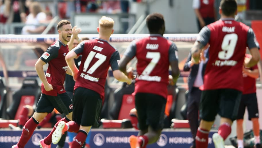 NUREMBERG, GERMANY - JULY 30:  Kevin Moehwald of Nuernberg celebrates his team's third goal with team mates during the Second Bundesliga match between 1. FC Nuernberg and 1. FC Kaiserslautern at Max-Morlock-Stadion on July 30, 2017 in Nuremberg, Germany.  (Photo by Alex Grimm/Bongarts/Getty Images)