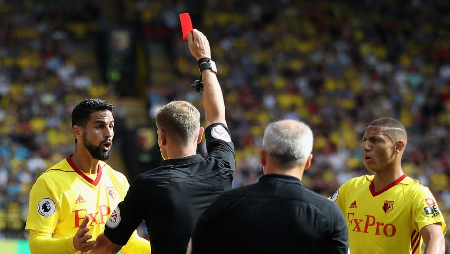 WATFORD, ENGLAND - AUGUST 26:  Referee Graham Scott shows a red card to Miguel Britos of Watford during the Premier League match between Watford and Brighton and Hove Albion at Vicarage Road on August 26, 2017 in Watford, England.  (Photo by Julian Finney/Getty Images)