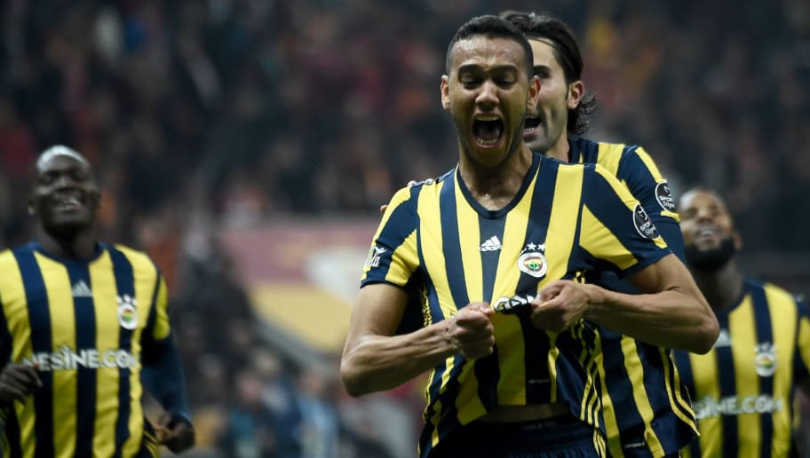 Fenerbahce's Brazilian midfielder Josef de Souza (C) celebrates after scoring a goal during the Turkish Super Lig football match between Galatasaray and Fenerbahce at theTT Arena stadium in Istanbul on April 23, 2017.  / AFP PHOTO / OZAN KOSE        (Photo credit should read OZAN KOSE/AFP/Getty Images)