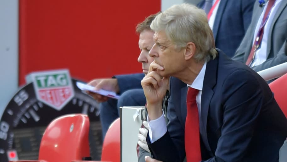 Arsenal's French manager Arsene Wenger looks on during the English Premier League football match between Liverpool and Arsenal at Anfield in Liverpool, north west England on August 27, 2017. Liverpool won the game 4-0. / AFP PHOTO / Anthony Devlin / RESTRICTED TO EDITORIAL USE. No use with unauthorized audio, video, data, fixture lists, club/league logos or 'live' services. Online in-match use limited to 75 images, no video emulation. No use in betting, games or single club/league/player publications.  /         (Photo credit should read ANTHONY DEVLIN/AFP/Getty Images)