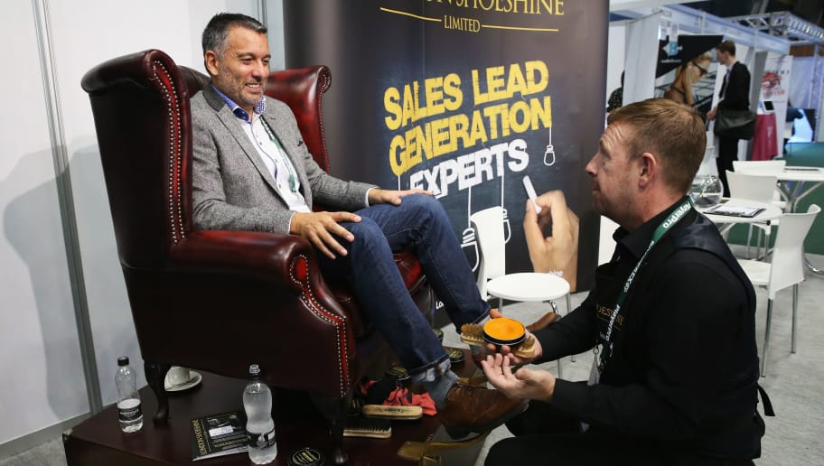 MANCHESTER, ENGLAND - SEPTEMBER 26: Guillem Balague, Sky Sports journalist has his shoes polished during day 1 of the Soccerex Global Convention 2016 at Manchester Central Convention Complex on September 26, 2016 in Manchester, England.  (Photo by Barrington Coombs/Getty Images for Soccerex)