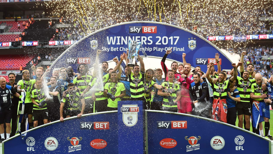 Huddersfield Town's players celebrate with the Championship Playoff trophy after winning the penalty shoot-out in the English Championship play-off final football match between Huddersfield Town and Reading at Wembley Stadium in London on May 29, 2017. Huddersfield won the penalty shoot-out 4-3 after the game finished 0-0 after extra time. / AFP PHOTO / Glyn KIRK / NOT FOR MARKETING OR ADVERTISING USE / RESTRICTED TO EDITORIAL USE        (Photo credit should read GLYN KIRK/AFP/Getty Images)