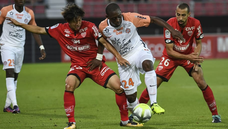 Montpellier's French defender Jerome Roussillon (C) vies with Dijon's South Korean midfielder Chang Hoon Kwon (L) and Dijon's French defender Fouad Chafik (R) during the Ligue1 football match Dijon FCO against Montpellier HSC at The Gaston Gérard Stadium in Dijon, north-eastern France on August 26, 2017.       / AFP PHOTO / PHILIPPE DESMAZES        (Photo credit should read PHILIPPE DESMAZES/AFP/Getty Images)