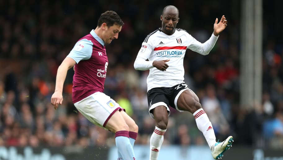 LONDON, ENGLAND - APRIL 17: Tommy Elphick of Aston Villa and Sone Aluko of Fulham in action during the Sky Bet Championship match between Fulham and Aston Villa at Craven Cottage on April 17, 2017 in London, England.  (Photo by Alex Pantling/Getty Images)
