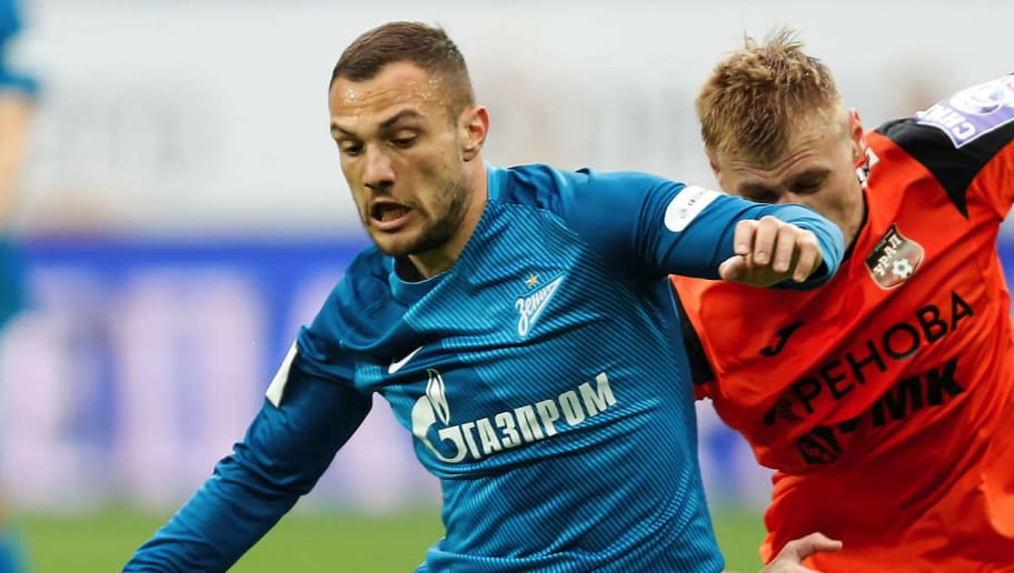 SAINT PETERSBURG, RUSSIA - APRIL 22: Yohan Mollo (L) of FC Zenit St. Petersburg and Roman Yemelyanov of FC Ural Ekaterinburg vie for the ball during the Russian Football League match between FC Zenit St. Petersburg and FC Ural Ekaterinburg at St. Petersurg stadium on April 22, 2017 in St. Peterburg, Russia. (Photo by Epsilon/Getty Images)