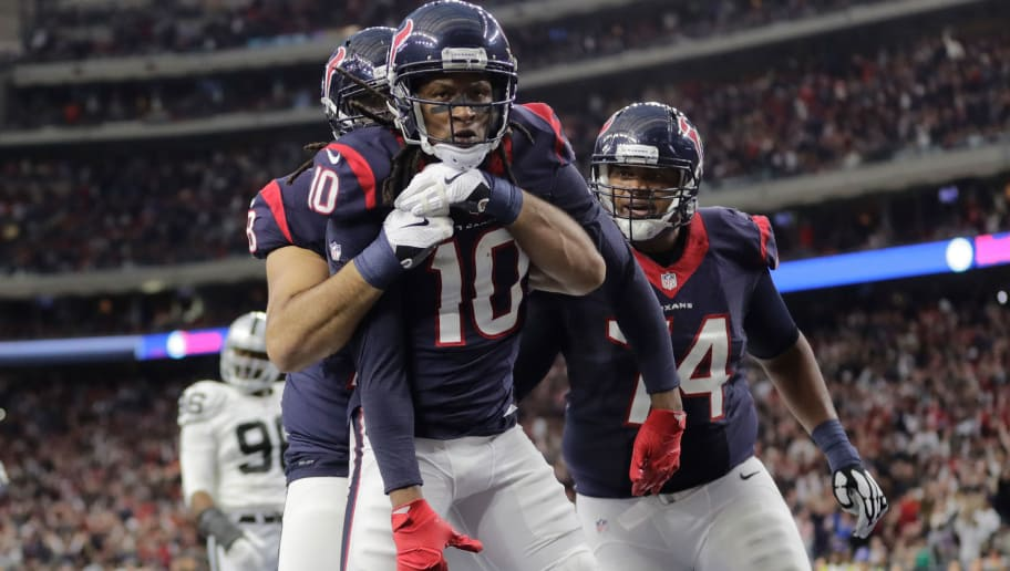 HOUSTON, TX - JANUARY 07:  DeAndre Hopkins #10 of the Houston Texans celebrates after catching a touchdown pass during the second quarter of the AFC Wild Card game against the Oakland Raiders at NRG Stadium on January 7, 2017 in Houston, Texas.  (Photo by Tim Warner/Getty Images)