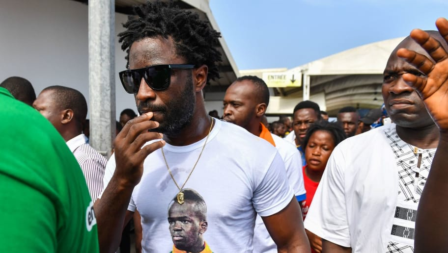 Ivory Coast forward Wilfried Bony (L) attends the arrival of the casket of the late Ivory Coast midfielder Cheick Tiote, on June 15, 2017 upon its arrival from China at Abidjan's airport, prior to his funeral ceremony.  The 52-time capped star, a member of the Ivory Coast squad that ended a 23-year drought in winning the 2015 Africa Cup of Nations, died after fainting during training with second division side Beijing Enterprises on June 5. He was 30. / AFP PHOTO / ISSOUF SANOGO        (Photo credit should read ISSOUF SANOGO/AFP/Getty Images)