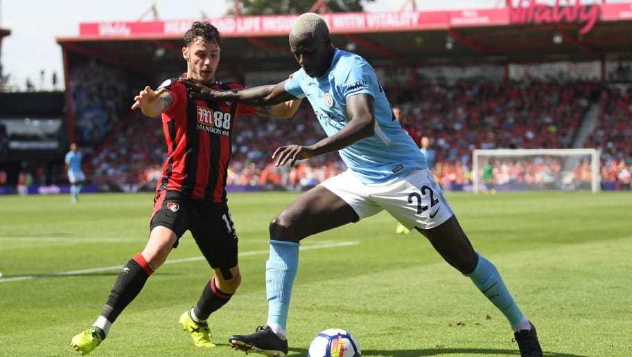 BOURNEMOUTH, ENGLAND - AUGUST 26:  Benjamin Mendy of Manchester City holds off Adam Smith of Bournemouth during the Premier League match between AFC Bournemouth and Manchester City at Vitality Stadium on August 26, 2017 in Bournemouth, England.  (Photo by Mike Hewitt/Getty Images)