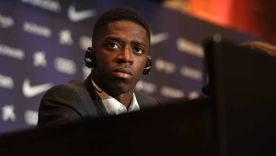 Barcelona's new player Ousmane Dembele looks on as he gives a press conference at the Camp Nou stadium in Barcelona, during his official presentation at the Catalan football club, on August 28, 2017. French starlet Ousmane Dembele agreed a five-year deal with Barcelona worth 105 million euros ($125 million) plus add-ons. Dembele, 20, moves from Borussia Dortmund, where he has been suspended since he boycotted training on August 10 in protest after the German club rejected Barca's first bid.  / AFP PHOTO / LLUIS GENE        (Photo credit should read LLUIS GENE/AFP/Getty Images)