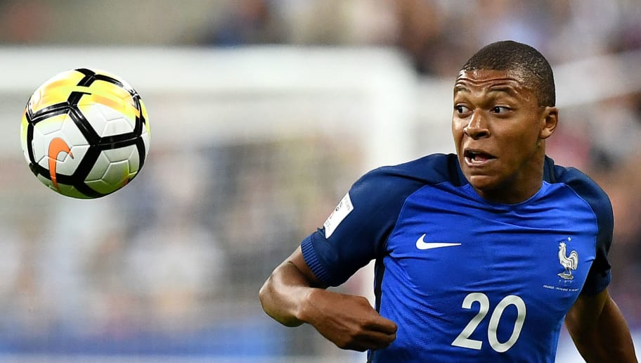 France's forward Kylian Mbappe eyes the ball during the FIFA World Cup 2018 qualifying football match France vs the Netherlands on August 31, 2017 at the Stade de France stadium in Saint-Denis, north of Paris.    / AFP PHOTO / FRANCK FIFE        (Photo credit should read FRANCK FIFE/AFP/Getty Images)