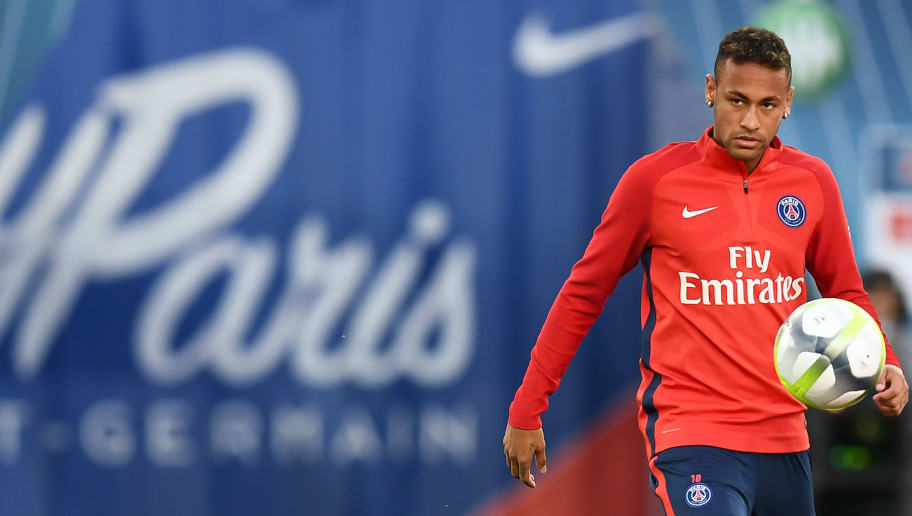 Paris Saint-Germain's Brazilian forward Neymar warms up ahead of the French Ligue 1 football match between Paris Saint-Germain (PSG) and Saint-Etienne (ASSE) at the Parc des Princes stadium in Paris on August 25, 2017. / AFP PHOTO / FRANCK FIFE        (Photo credit should read FRANCK FIFE/AFP/Getty Images)