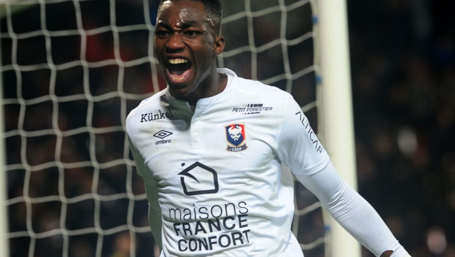 Caen's French forward Yann Karamoh celebrates after scoring during the French L1 football match Guingamp against Caen on February 4, 2017 at the Roudourou stadium in Guingamp, western of France. / AFP / FRED TANNEAU        (Photo credit should read FRED TANNEAU/AFP/Getty Images)