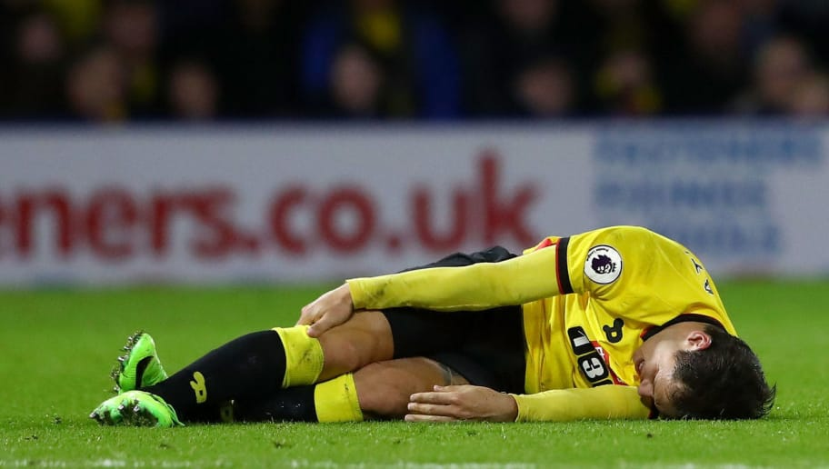 WATFORD, ENGLAND - FEBRUARY 25:  An injured Mauro Zarate of Watford lays on the turf during the Premier League match between Watford and West Ham United at Vicarage Road on February 25, 2017 in Watford, England.  (Photo by Matthew Lewis/Getty Images)