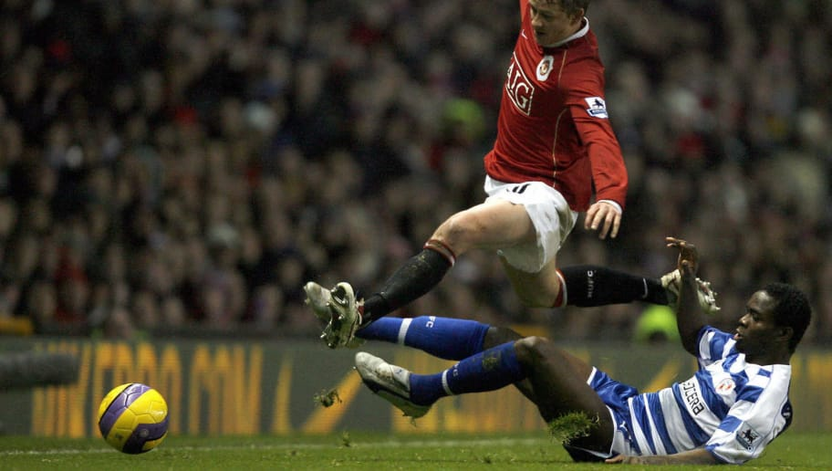Manchester, UNITED KINGDOM:  Manchester United's Ole Gunnar Solskjaer (L) is fouled by Reading's Sam Sodje during their English Premiership football  match  at Old Trafford , Manchester, North-west  England, 30  December, 2006. AFP PHOTO/ANDREW YATES   Mobile and website use of domestic English football pictures subject to subscription of a license with Football Association Premier League (FAPL) tel : +44 207 298 1656. For newspapers where the football content of the printed and electronic versions are identical, no licence is necessary.  (Photo credit should read ANDREW YATES/AFP/Getty Images)