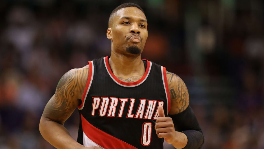 PHOENIX, AZ - MARCH 12:  Damian Lillard #0 of the Portland Trail Blazers during the first half of the NBA game against the Phoenix Suns at Talking Stick Resort Arena on March 12, 2017 in Phoenix, Arizona.  NOTE TO USER: User expressly acknowledges and agrees that, by downloading and or using this photograph, User is consenting to the terms and conditions of the Getty Images License Agreement.  (Photo by Christian Petersen/Getty Images)