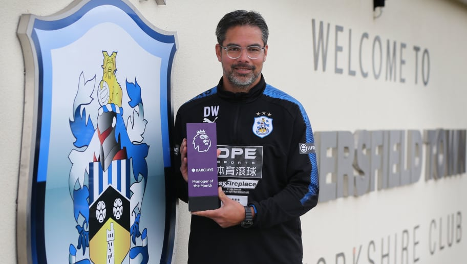 HUDDERSFIELD, ENGLAND - SEPTEMBER 07: David Wagner of Huddersfield Town poses with the Barclays Manager of the Month Award for August 2017 September 7, 2017 in Huddersfield, England. (Photo by Nigel Roddis/Getty Images for Premier League)