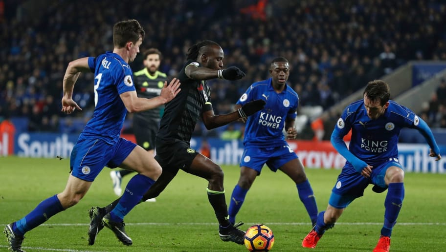Chelsea's Nigerian midfielder Victor Moses (C) weaves his way through the Leicester defence during the English Premier League football match between Leicester City and Chelsea at King Power Stadium in Leicester, central England on January 14, 2017. Chelsea won the game 3-0. / AFP / Adrian DENNIS / RESTRICTED TO EDITORIAL USE. No use with unauthorized audio, video, data, fixture lists, club/league logos or 'live' services. Online in-match use limited to 75 images, no video emulation. No use in betting, games or single club/league/player publications.  /         (Photo credit should read ADRIAN DENNIS/AFP/Getty Images)