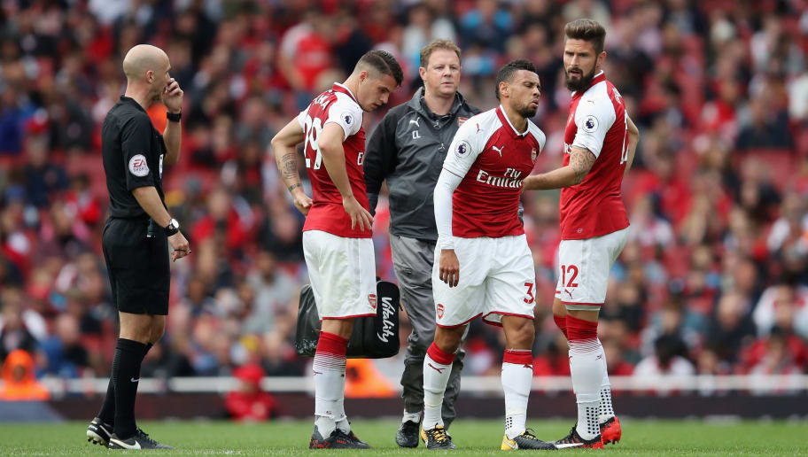 LONDON, ENGLAND - SEPTEMBER 09: Francis Coquelin of Arsneal pulls up injured during the Premier League match between Arsenal and AFC Bournemouth at Emirates Stadium on September 9, 2017 in London, England.  (Photo by Julian Finney/Getty Images)