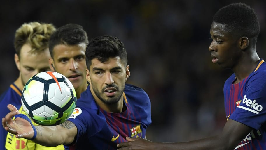 Barcelona's Uruguayan forward Luis Suarez (L) grabs the ball next to Barcelona's French forward Ousmane Dembele (R) during the Spanish Liga football match Barcelona vs Espanyol at the Camp Nou stadium in Barcelona on September 9, 2017. / AFP PHOTO / LLUIS GENE        (Photo credit should read LLUIS GENE/AFP/Getty Images)
